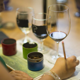 Woman taking notes while participating in the Aromatherapy Interactive Wine Experience at St. Supéry
