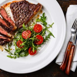 Grilled Flat Iron Steak with Heirloom Tomatoes and Toasted Spice Vinaigrette