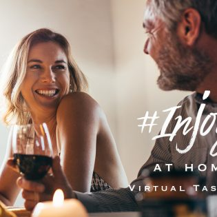 Couple enjoying a glass of wine at a st. supéry virtual wine tasting