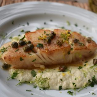Seared Halibut in Anchovy and Caper Brown Butter over Onion and Fennel Sauce Soubise